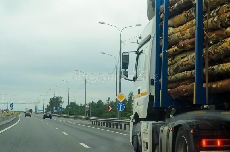 Truck carrying wood on highway. Wood processing industry.  stock image
