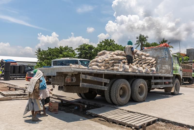 Truck with cement bags in Paotere Old Port of Makassar, South Sulawesi, Indonesia stock photos
