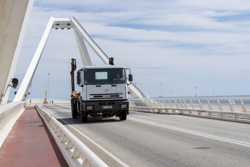 Truck circulating for a bridge. Barcelona, Spain - March 24, 2014: A truck Iveco circulating a drawbridge Barcelona port stock photos