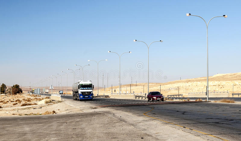 Truck circulating in a desert. Highway shobaken Jordan on a sunny day. It is an editorial image stock images