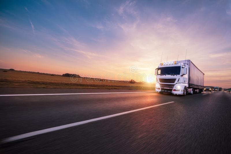 Truck with container on road, cargo transportation concept. royalty free stock photography