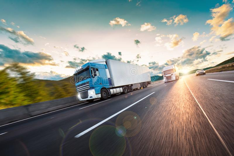 Truck with container on road, cargo transportation concept. stock image