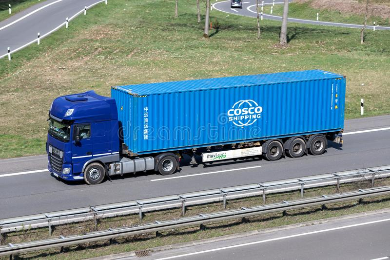 Truck with COSCO container. On German motorway stock photography