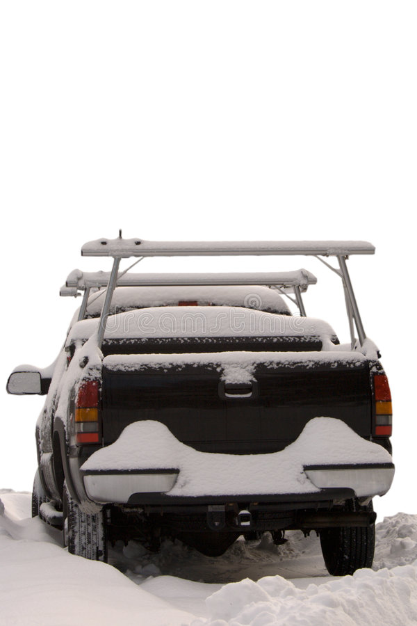 Truck covered with snow stock images
