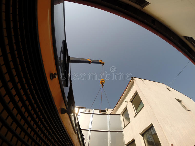 Truck Crane in Action. Crane truck in action lifting the steel container frog perspective stock photography