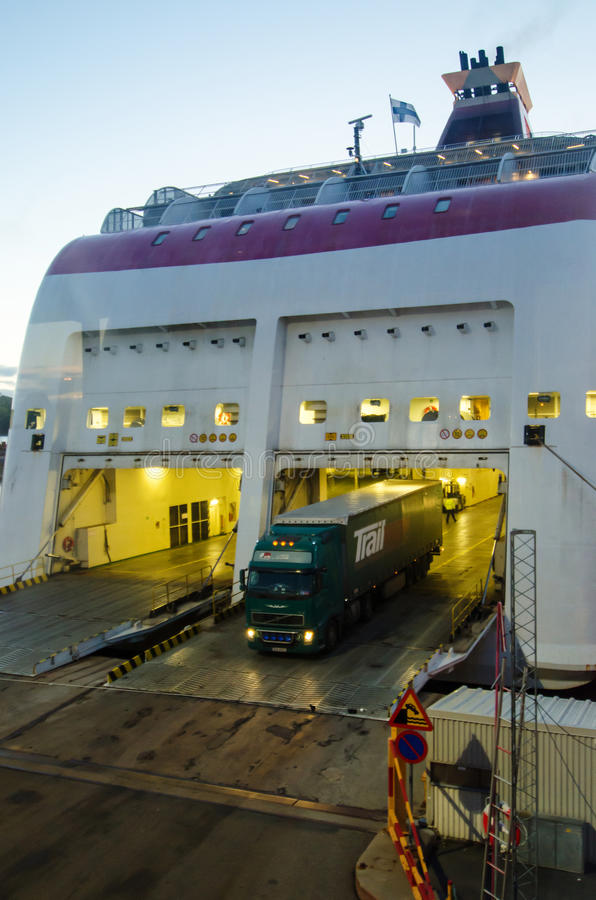 Truck disembarking from docked ship