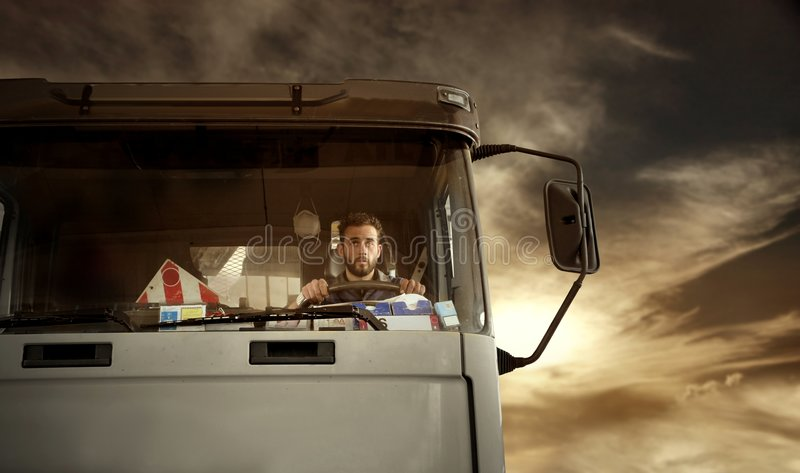Truck driver. Portrait of truck driver at the sunset stock photography