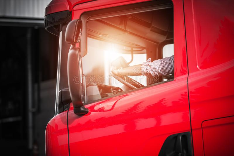 Truck Driver Job. Caucasian Driver in His Euro Semi Truck royalty free stock photography