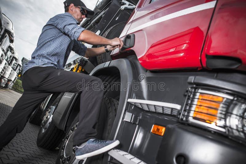 Truck Driver Job Theme. Semi Truck Driver Job Theme. Caucasian Driver and His Vehicle royalty free stock photo