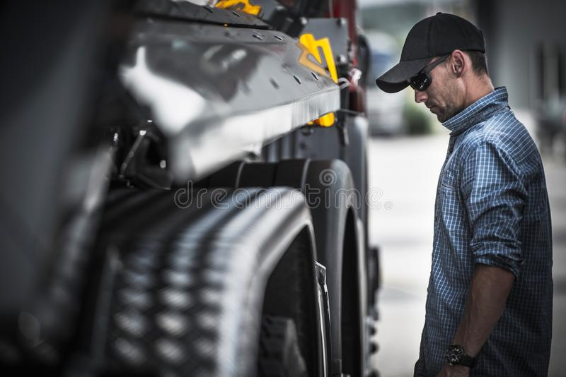 Truck Driver Load Check. Caucasian Semi Truck Driver Checking on His Vehicle and the Load royalty free stock photos