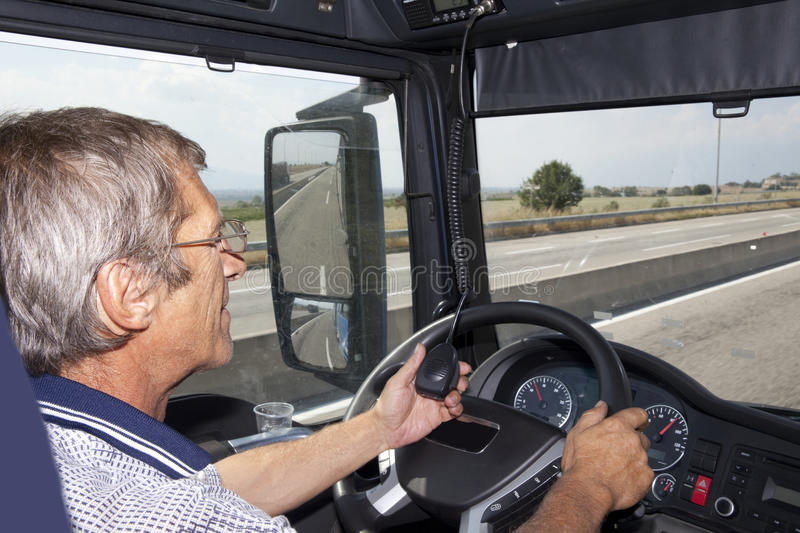 Truck Driver Radio. Truck driver speaking on the radio stock images