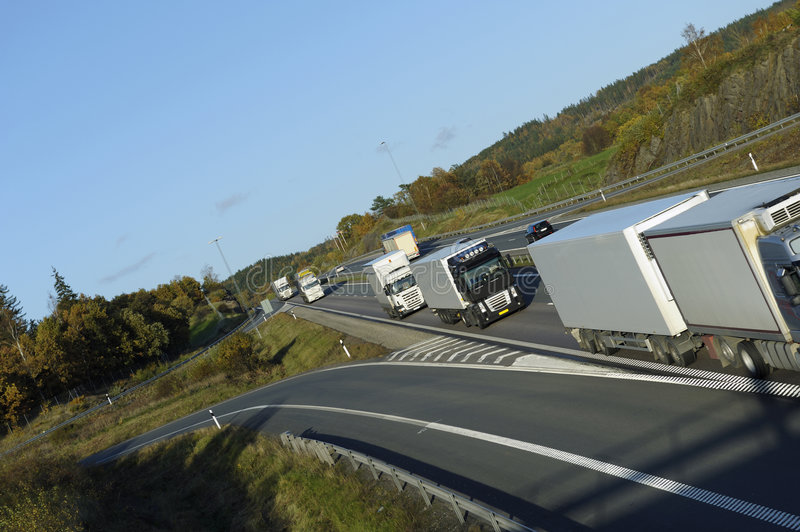 Download Truck driving convoy stock image. Image of transport, hauling - 7098361