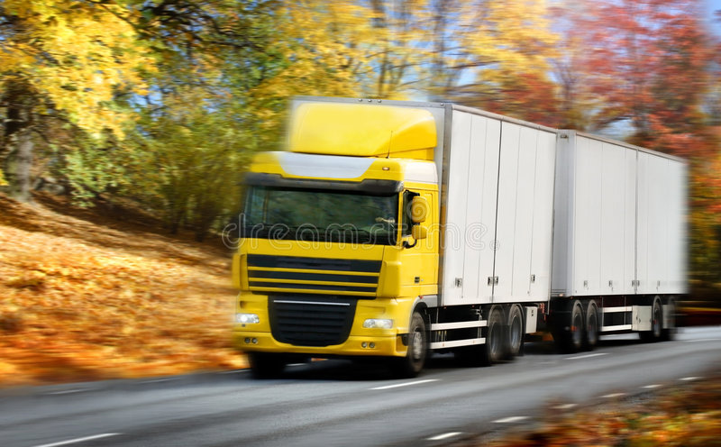 Truck driving on country-road/motion royalty free stock photo