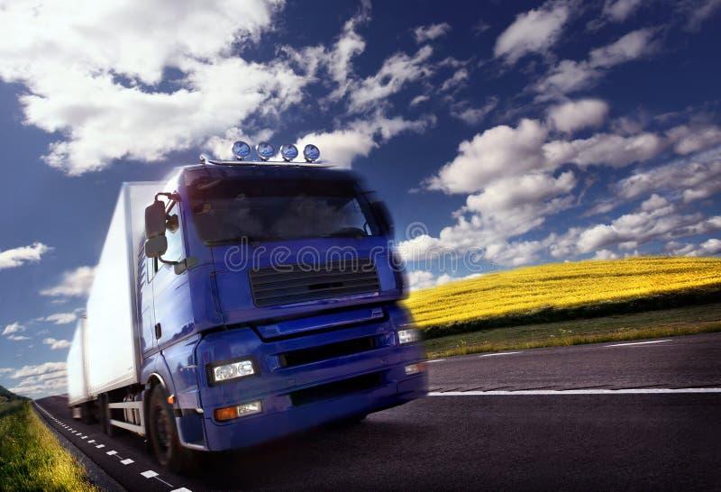 Truck driving at dusk/motion blur