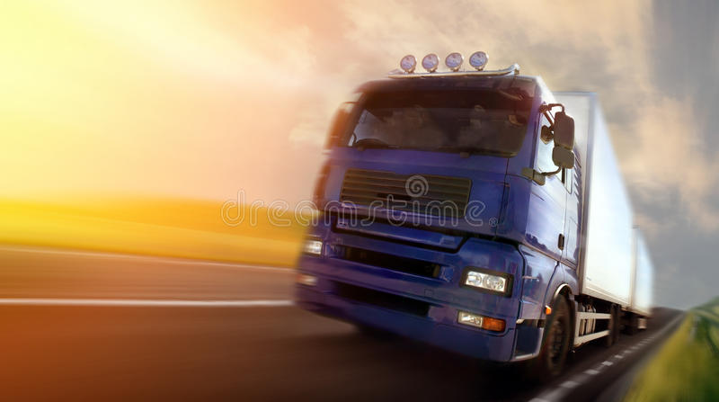 Truck driving at dusk/motion blur stock photography