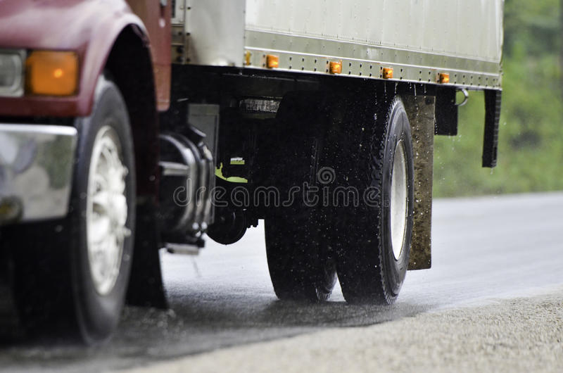 Download Truck driving in rain stock photo. Image of products - 26256366