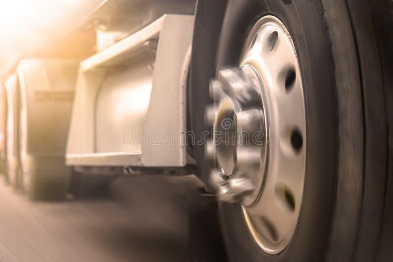 Truck driving on road. truck wheel closeup, transportation, Motion blur stock photo