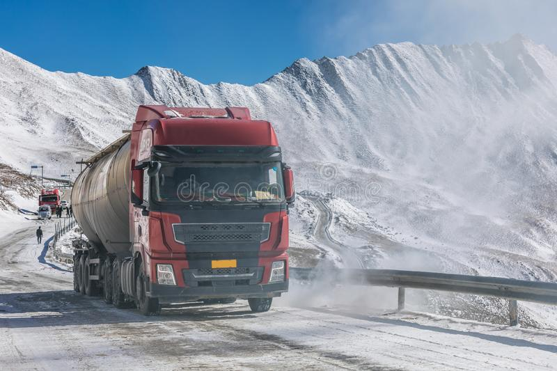 Truck driving on uphill in mountain at winter stock images