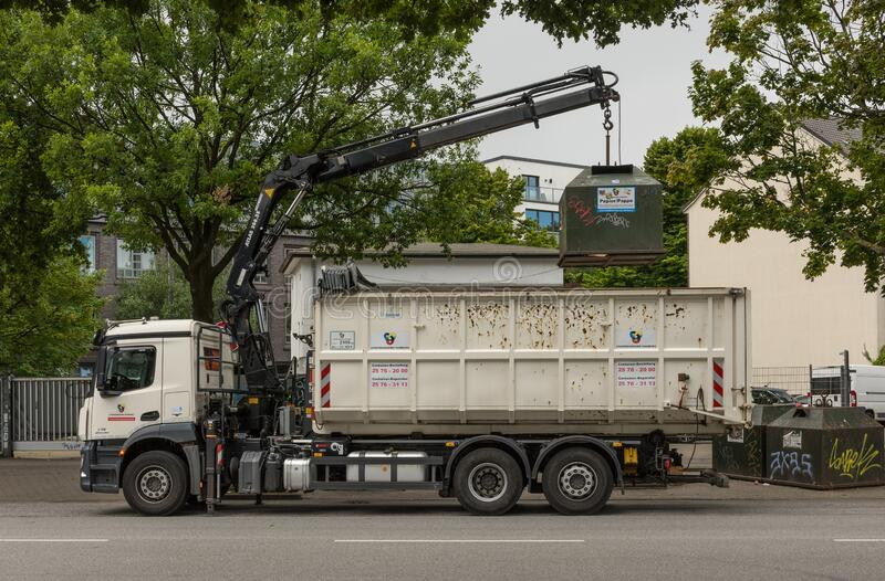 A truck empties a waste paper container in Hamburg, Germany.  royalty free stock photos