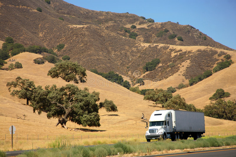 Truck on freeway stock photography