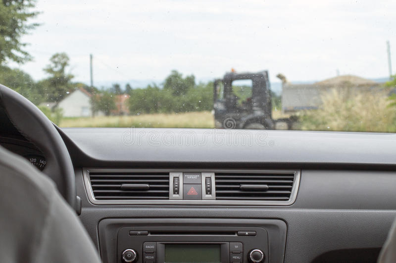 Truck in front of the car. View through dirty window from inside the car on the truck that intersects the path of movement royalty free stock photos