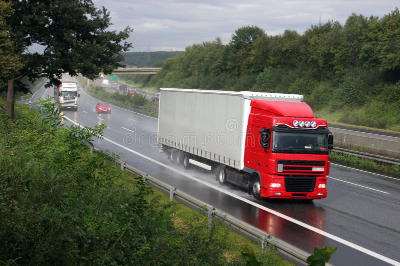 Truck on German Autobahn. Large truck travelling on German Autobahn royalty free stock images