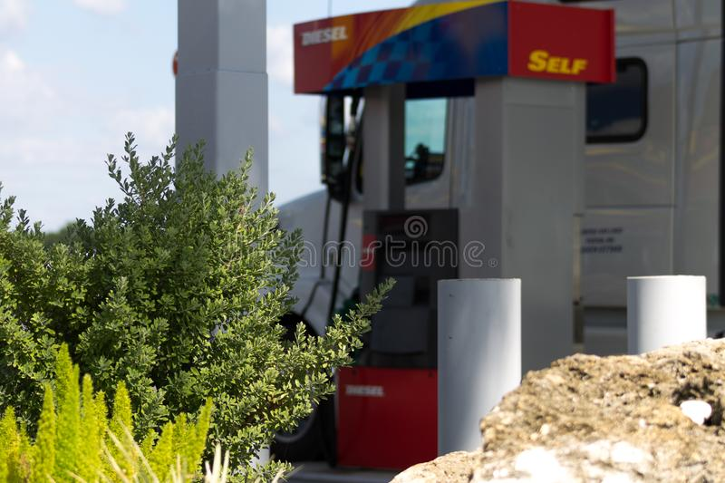 Truck getting fuel stock images