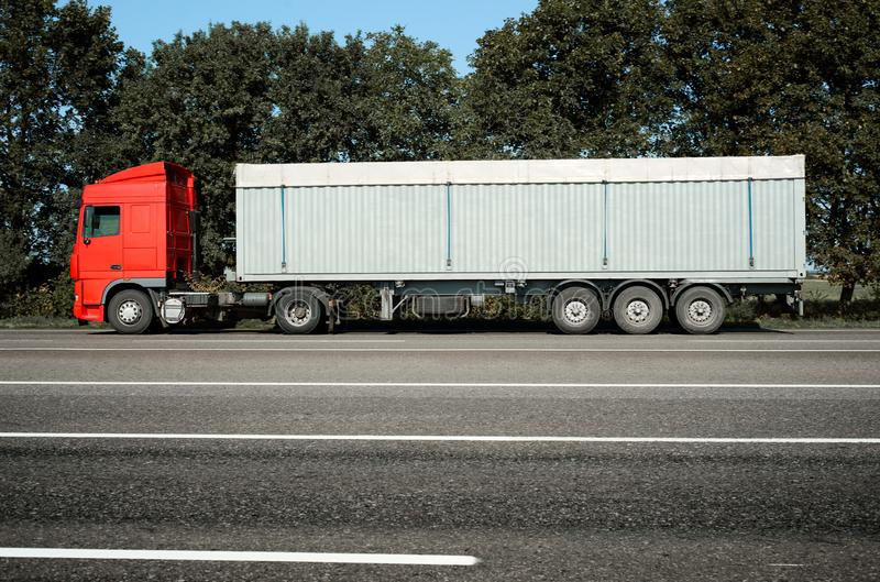 Truck is going along the road. Cargo transportation concept royalty free stock photography