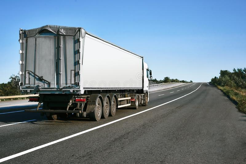 The truck is going up the road. Cargo transportation concept stock photos