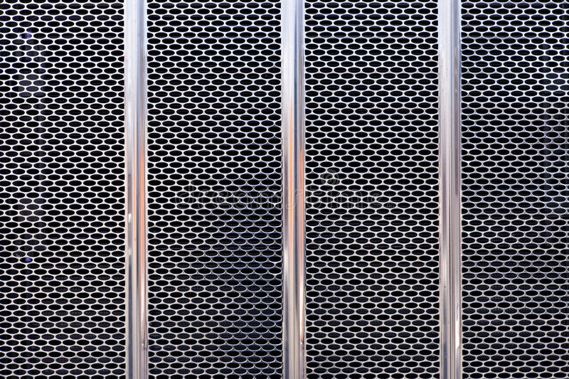 Truck grill 1. Close-up picture of the front chromed grill of a truck (long-haul type royalty free stock image