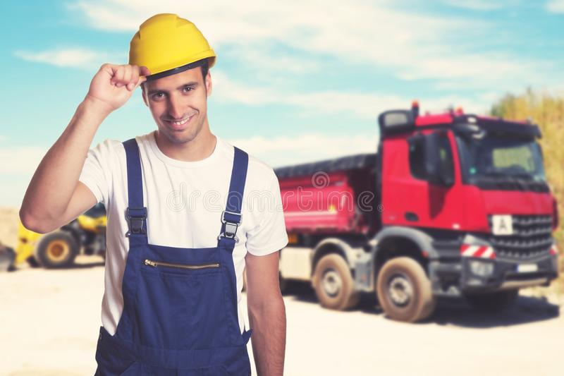 Truck with handsome latin american construction worker stock photos