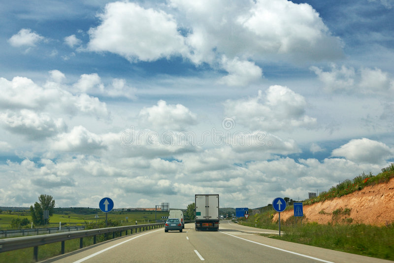 Truck on a highway. Interstate delivery truck on a highway against the cloudy spring day royalty free stock photography