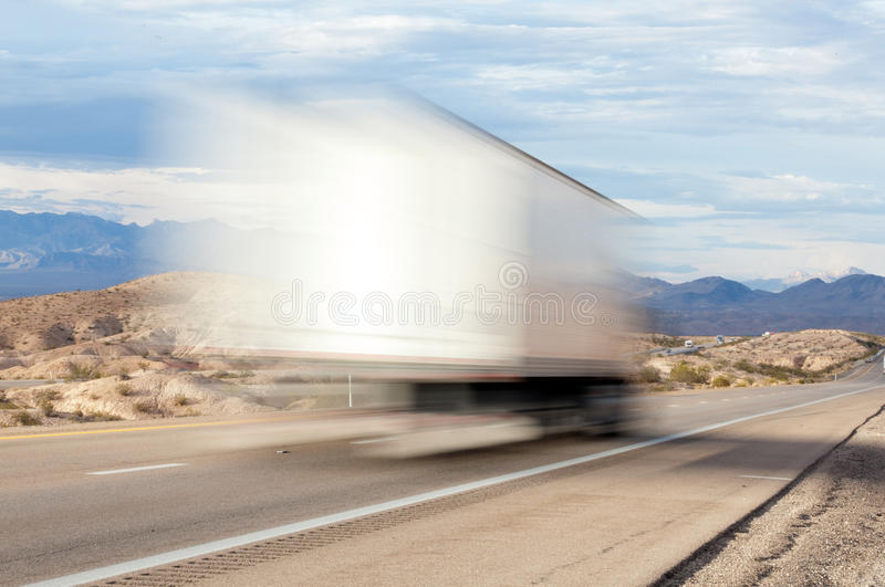 Truck On A Highway In The Desert Stock Photography