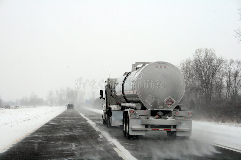 Truck on Highway during Winter Storm stock photos
