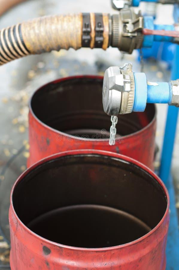 Download Truck Hoses For Fuel Station, Oil Barrels Stock Photography - Image: 21877612
