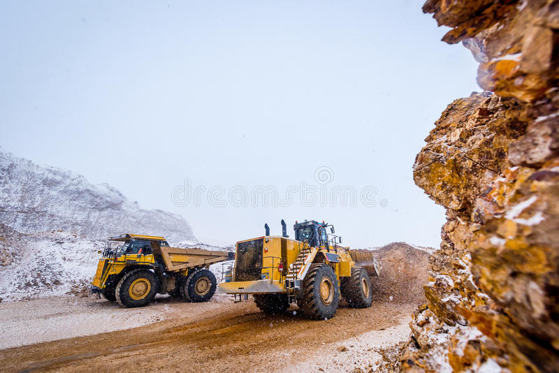 Truck loading. Gold mining. At an open pit royalty free stock photos