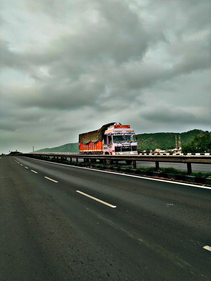 Truck lover on highways monsoon click royalty free stock images