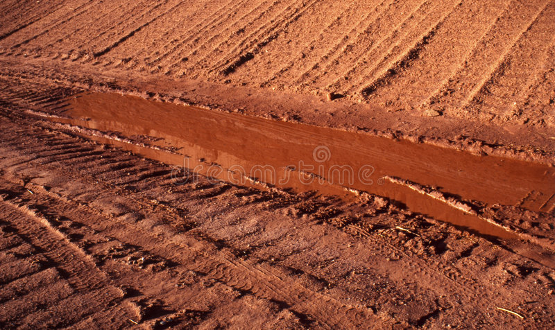 Truck marks on a dirt road stock photography