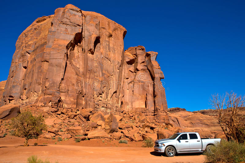 With truck in Monument Valley stock image