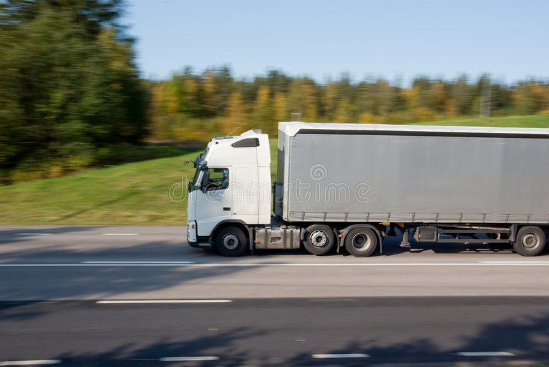 Truck in motion stock photos