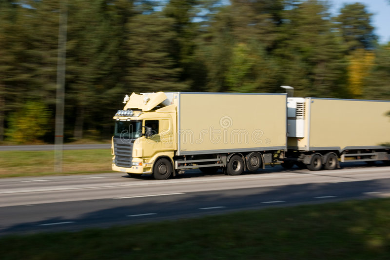 Truck in motion stock images