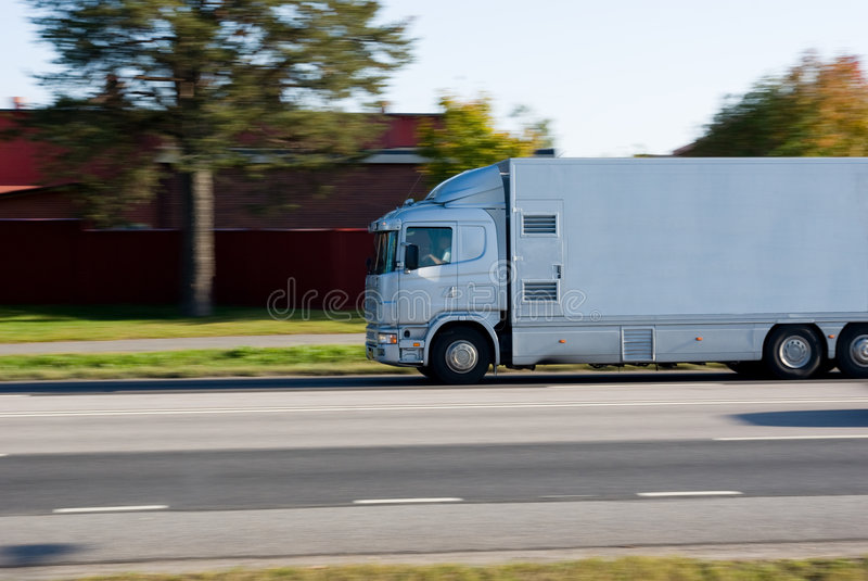 Truck in motion royalty free stock photo