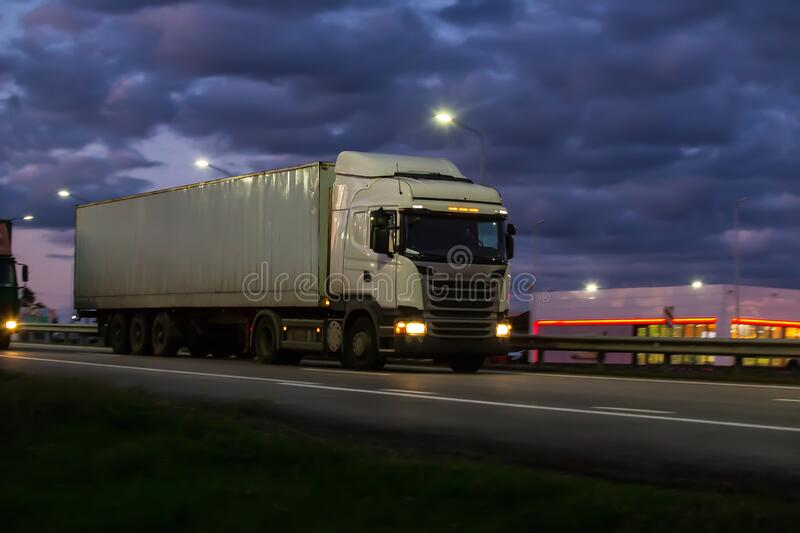 Truck moves on country highway royalty free stock images