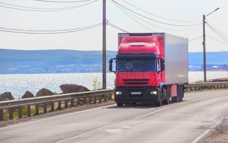 Truck is moving along the road. Truck is moving along the coastal road royalty free stock photography