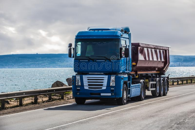 Truck is moving along the road. Truck is moving along the coastal road royalty free stock photo