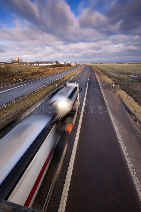 Truck moving fast. stock images