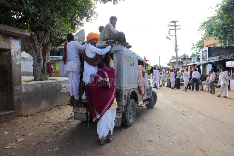 A truck overcrowded with passengers. In Pushkar,Rajasthan,India on October 18 ,2010. Pushkar fair is held annually in Rajasthan to trade camels, horses and stock photography