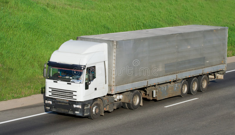 The truck on a road royalty free stock photos
