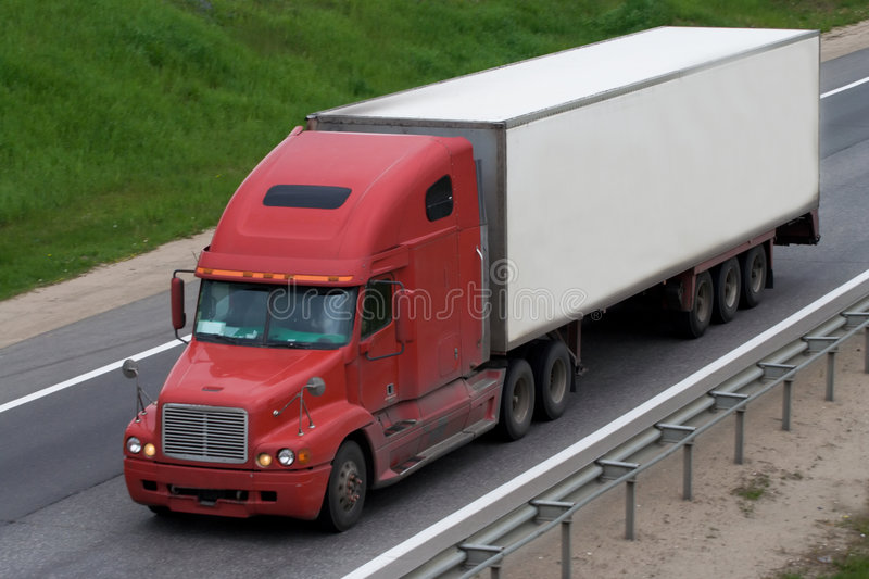 The truck on a road stock images
