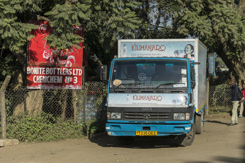 Truck on the road in Tanzania. Auto Truck traveling on the road in Arusha city in Tanzania. Africa stock photo